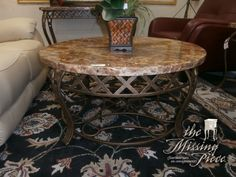"""Perfect for you petite space! Round, 36"""" top faux marble top coffee table with scrolled metal base. Measures 36*36*19."""