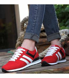 Women's #red leather shoe #sneakers with stripe pattern, sewing thread design, Lace up style, Round toe design, casual sport, athletic occasions.