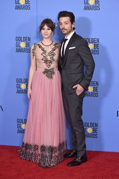 Felicity Jones Photos Photos - Actor Felicity Jones and Diego Luna pose in the press room during the 74th Annual Golden Globe Awards at The Beverly Hilton Hotel on January 8, 2017 in Beverly Hills, California. - 74th Annual Golden Globe Awards - Press Room