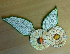 leaves made of paper stitched onto felt.