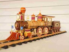 Gorgeous wooden steam engine (I don't know the source.)  Looks like Union Pacific flags, at the front.