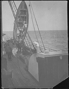 This photo is said to be the Carpathia hoisting one of the Titanic's lifeboats up to drain it from water.