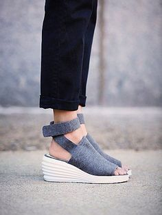 Sport Wedge   Slip-on sport jersey wedges with a Velcro closure on the ankle wrap.  Comfortable, padded footbed.    *By Jeffrey Campbell
