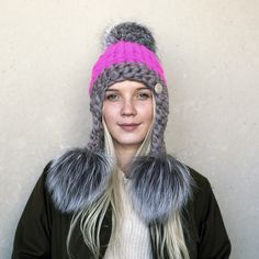 New York designer Mischa Lampert hand-spins, hand-dyes, and then hand-knits  the super soft, super thick and warm New Zealand merino yarn that goes into  each of these unique and delicious creations.  Mixed grey and magenta wool with triple lynx fur poms.    See more goods from Mischa Lampert