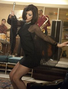 Google Image Result for http://img.photobucket.com/albums/v441/antbabe/more%2520photos/Mad-Men-Jessica-Pare-Megan-little-black-dress-singing-song-season-5-premiere.jpg