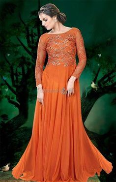 Gorgeous orange net party wear gown is designed with embroidery, resham, zari and patch border work. Available with matching net dupatta. (Slight variation in actual color is possible. Designer Evening Gowns, Designer Wedding Gowns, Designer Gowns, Indian Ladies Dress, Indian Gowns, Colored Wedding Gowns, Ladies Salwar Kameez, Net Gowns, Ethnic Wear Designer