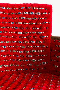 hundreds of eyes make up the scopophilia chair by fiona roberts 2