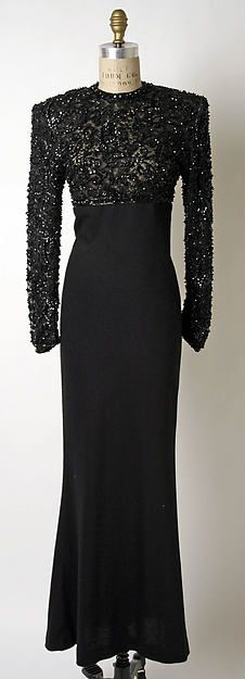 This is an evening dress by James Galanos. It was worn by first lady Nancy Reagan, who was known for her extravagant style. It is from 1980 and made of black cashmere.