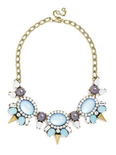 This gem collar features cloudy blue stones and gold spikes in a slightly futuristic silhouette, but an overdose of pavé crystals and blue pearls makes the look undeniably glam.
