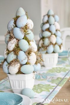 Easter Egg Topiary - 25 Easy Spring Decorating Ideas We're DIYing this Weekend - Southernliving. This Easter egg topiary is a lot easier than it looks. You should be able to find similar white planters at your local craft store for less that $5 each.  Get the tutorial here.