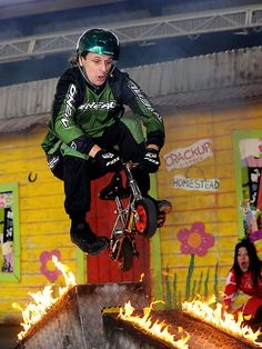 Stuntman Jim from Freestyle Pedal Cross performing a very dangerous stunt. Picture: Paul Guy | Ekka 2012 launch | The Courier-Mail