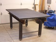 Awesome welding table, I-beam supports with replaceable c-channel as the top. Perfect for clamping and it looks sick!