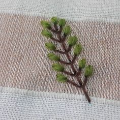 Fly stitch branch and straight stitch leaves.  #embroidery #embroideryart…