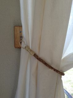 Rustic decor- DIY rope tie backs and horse shoe nail hooks