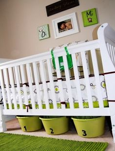 Cute & cheap: Under-crib storage using buckets covered with pretty fabric