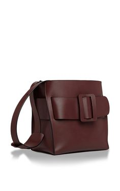 This **BOYY** shoulder bag is rendered in burgundy calfskin, and features an expandable oversize belt buckle with inner clasp closure as well as detachable inner handle and shoulder strap