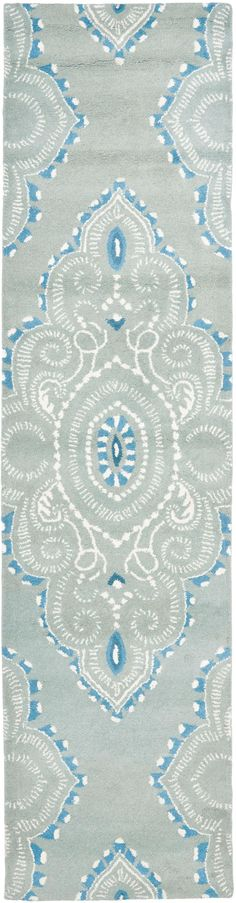 WYD372A Rug from Wyndham collection.  Safavieh's artistry is vividly displayed in the Wyndham collection with designs ranging from contemporary florals to traditional global motifs.  Each richly-hued rug is hand-tufted by master weavers in India of top quality wool. Several designs recreate the one-of-a-kind look of fashionable over-dyed antique rugs using a special multi-colored yarn that is meticulously colored using ages-old pot dyeing techniques. After the dye is carefully applied to…
