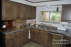 Gray laminate countertops with ashy brown cabinets! Great combination!