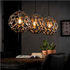 The ceiling light Dimmock has three rounded pendants made of aluminium, with a sandy touch. The lamp is finished in vintage bronze which makes it a contemporary looking lamp. It is adjustable in height up to 150 cm. Dining Room Lighting, Bar Lighting, Home Lighting, Chandelier Lighting, Industrial Ceiling Lights, Kitchen Ceiling Lights, African Room, Living Colors, Led Filament