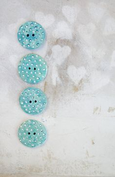 large blue buttons with little white dots by Dprintsclayful