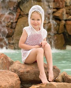FREE CROCHET PATTERN for a kid's hoodie cover up with a matching swimsuit pattern on same page. Finally an appropriate girl's suit that's sort of in the style of mom's crochet suits. Too many of these are too adult for the girls. Give this one a whirl!