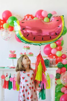 Crisp, sweet watermelon and a sunny afternoon are the perfect recipe for this Watermelon party! Shades of red, pink & green embellish everything from the fancy balloon garland to the watermelon sugar cookies and party papery. It's a super fruity soiree that's extra juicy & delicious!