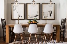 In her Texas dining room, Gaia founder Paula Minnis paired two antique chairs that belonged to her mother with a set of midcentury-style seats. Dining Room Sets, Dining Area, Dining Chairs, Saarinen Table, Antique Chairs, Love Home, Living Room Decor, Sweet Home, New Homes
