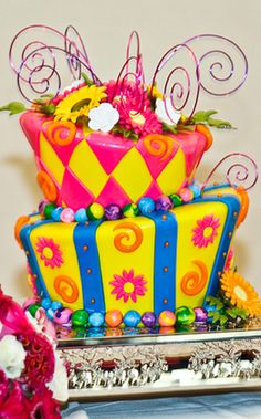 This week's Wedding Cake Wednesday is a colorful delight perfect for the coming (hopefully) warmer weather. The colors and patterns of the two-tier fondant cake guarantee it will stand out as a focal point. Beautiful Cakes, Amazing Cakes, Disney Inspired Wedding, Disney Weddings, Mad Hatter Cake, Extreme Cakes, Alice In Wonderland Tea Party, Disney Cakes, Cake Gallery