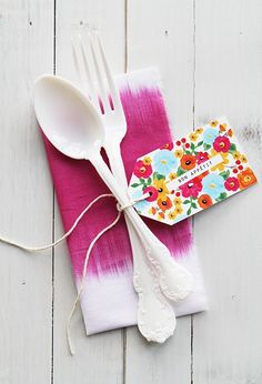 If you don't want a super formal place setting, you could replicate this with the caterer's silverware and add a DIY name tag and some funky napkins for super budget