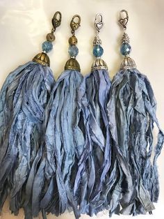 Items similar to Handcrafted Tassel Country Blue to Denim Sari Silk Tassel Bohemian Tassels Pendant Antique brass or Silver oval bead cap on Etsy Ribbon Jewelry, Tassel Jewelry, Fabric Jewelry, Tassel Earrings, Bohemian Jewelry, Jewelry Crafts, Boho, Seda Sari, Stacked Necklaces