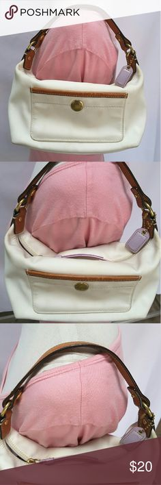 "Coach small handbag Coach small handbag with a front slip pocket, top zipper closure.?  Length 8.5"" height 5.5"" width 3"" strap drop 5""  White canvas is kind of dirty, lining is purple is slightly dirty and the leather trim is in excellent condition.?  Pets and smoking free home. Coach Bags Mini Bags"