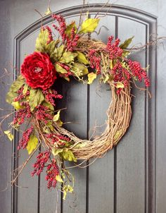 An original design by An Extraordinary Gift © Looking for something for everyday? This design is perfect for you!! I used an 18 grapevine base and filled it with artificial twigs and red berry branches. I also used a large red peony bloom as a beautiful focal point. I just love