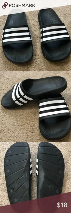 9c74a0e8e9c2 Shop Kids  adidas Black White size Sandals   Flip Flops at a discounted  price at Poshmark. Description  Adidas Duramo slide flip flop boys Size Pre  owned.