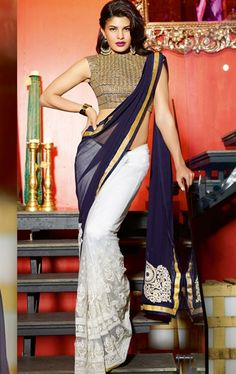 Buy online jacqueline fernandez blue and off white half and half saree. This beautiful jacqueline fernandez style half and half saree is prettified with heavy embroidery and zari work. Shop online bollywood replica attire now! Mode Bollywood, Bollywood Fashion, Bollywood Celebrities, Saree Fashion, Celebrities Fashion, Celebs, Bollywood Designer Sarees, Bollywood Saree, Indian Bollywood