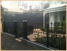Singular Front Yard Fence Image Concept Black Wrought Iron With Decorative Metal Front Yard Decor, Front Porch Design, Front Yard Fence, Fence Design, Front Yards, Yard Gates, Wrought Iron Fence Cost, Cast Iron Fence, Outdoor Landscaping