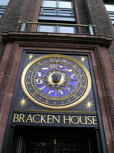 The elegant astronomical clock, the work of Philip Bentham in gilt, metal & enamel, embellished with Roman numerals, depicting months of the year, signs of the zodiac and a sunburst motif, has at its centre a face of Winston Churchill who was a personal friend of Bernard Bracken. Bracken House is named after Bernard Bracken, (former chairman of the Financial Times.) - near St Paul's Cathedral