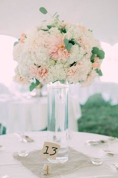 Tall Cylinder Centerpiece with large arrangement. Cafe au Lait Dahlias, Hydrangea, and Eucalyptus. Blush and Peach Wedding. Florals: Seven Sister Designs Photo: Hatch Photography