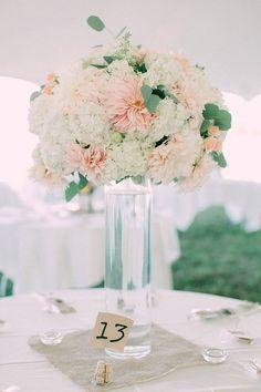 Tall Cylinder Centerpiece with large arrangement. Cafe au Lait Dahlias, Hydrangea, and Eucalyptus. Blush and Peach Wedding. Florals: Seven Sister Designs Photo: Hatch Photography