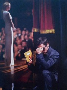 At the Oscars, 2012, RDJ strikes a Tebow pose just before Gwyneth Paltrow introduces him.