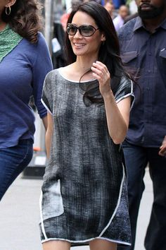 On the New York set for her TV show Elementary, Lucy Liu headed to her next scene in a monotone and printed dress. Liu's look was finished off with Tom Ford shades and her dark locks cascading over her shoulders.