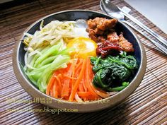 Bibimbap, the famed Korean rice dish is essentially mixed rice - namul or marinated vegetables, meat, usually an egg and gochujang (red pepper paste) served on top of a bed of rice. Rice Recipes, Asian Recipes, Cooking Recipes, Healthy Recipes, Ethnic Recipes, Korean Dishes, Korean Food, Korean Rice, Korean Bbq