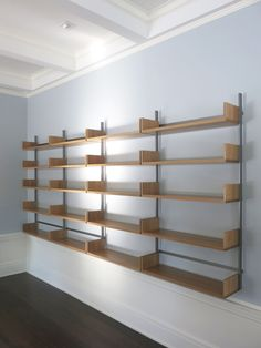 modular shelving system in white oak and cold-rolled steel, wall mounted furniture System Furniture, Modular Furniture, Home Office Furniture, Furniture Design, Modular Shelving, Shelving Systems, Showroom Interior Design, Interior Design Living Room, Home Office Design