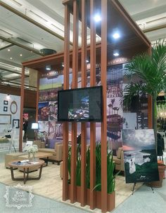In the detail: wood panel as the facade of Alila booth. Design, styling and decoration by http://balieventstyling.com