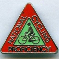 Cycling Proficiency test ---- Passed and always wore the badge with pride I do remember my badge being round and on my school photos it is.