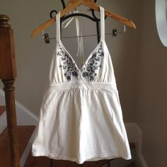 Victoria's Secret bra top Like new. Has removable pads. Cute top. Has a good quality shelf bra so you don't have to wear one. Very low v neck. Super sexy. To low for my comfort. Color is off white with black embroidery. Victoria's Secret Tops Tank Tops