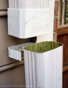 A Crafty Wife: Make Your Own Rain Barrel - 2 Hour (or Less) Project. No crazy gutter turns needed with this $8 rain water colander. Just slide into place and connect a hose to dump water into the rain barrel. Brilliant!