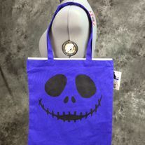 Hand painted blueberry bag with a happy skull design on it. Design is painted in black on one side only. Perfect for Halloween, conventions, trips to the comic shop, as a reusable shopping bag or as a purse.  Blueberry (Blueish purple) 100% cotton canvas promo bag (thinner than reg. canvas bags...