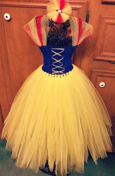 Snow white yellow, red, and blue tutu dress. This tutu dress is great for Halloween as a princess costume or as a birthday outfit for a snow white