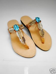 Handmade genuine leather sandals with gold leaf and aquamarine colored stone
