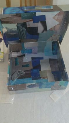 I turned an old shoe box into a pretty piece of storage by covering it in magazine cut-outs and sticky back plastic